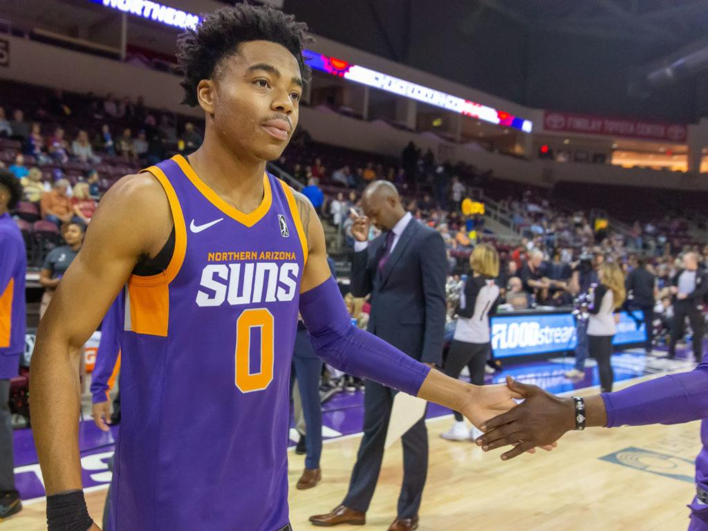 National Basketball Association player Jalen Lecque of the Phoenix Suns gives a teammate a high five on the court