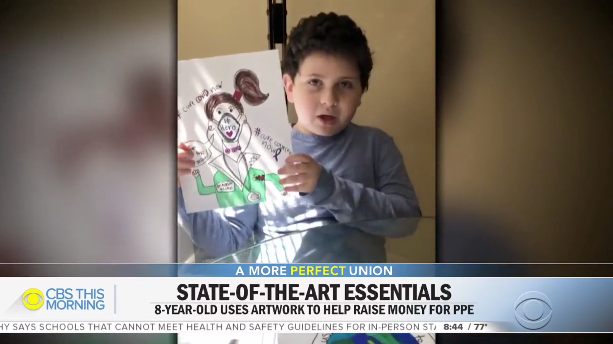 Eight-year-old youth artist Ethan Goldsmith shows a drawing he created to help raise money for Get Us PPE