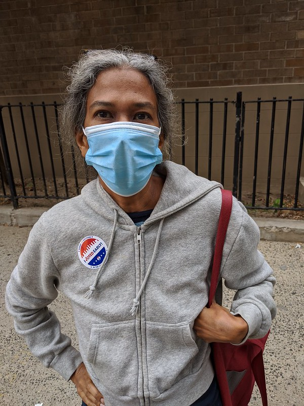 Early voter wearing mask