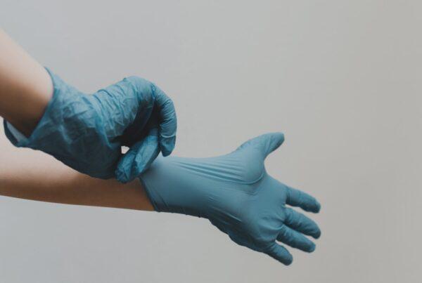 putting on nitrile gloves