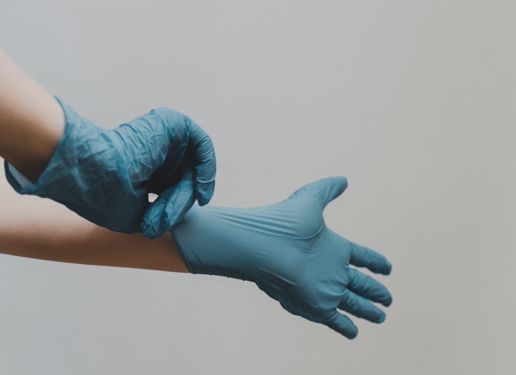putting on nitrile gloves