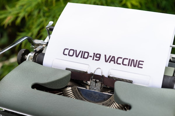 COVID-19 vaccine printed on typewriter