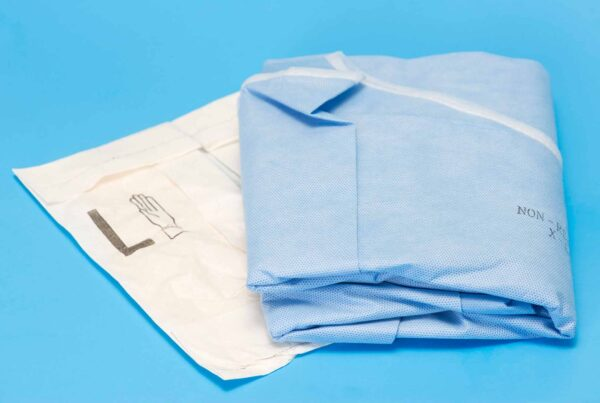 Surgical gown and sterile gloves