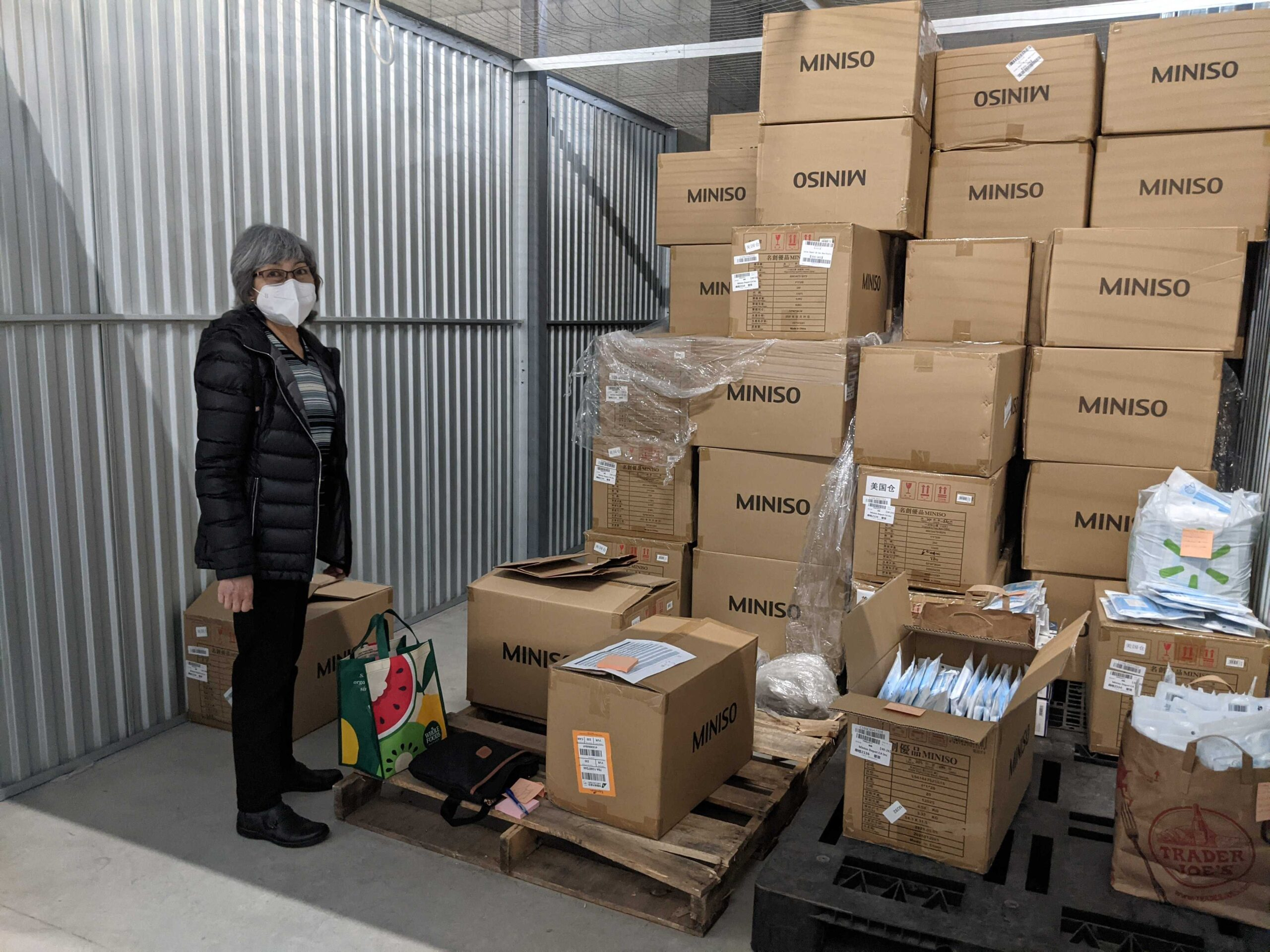 Ruth Robles-Goche with boxes of PPE for distribution