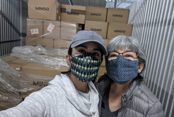 Joanna Calderon and her mom, Ruth Robles-Roche volunteer to distribute PPE in San Diego