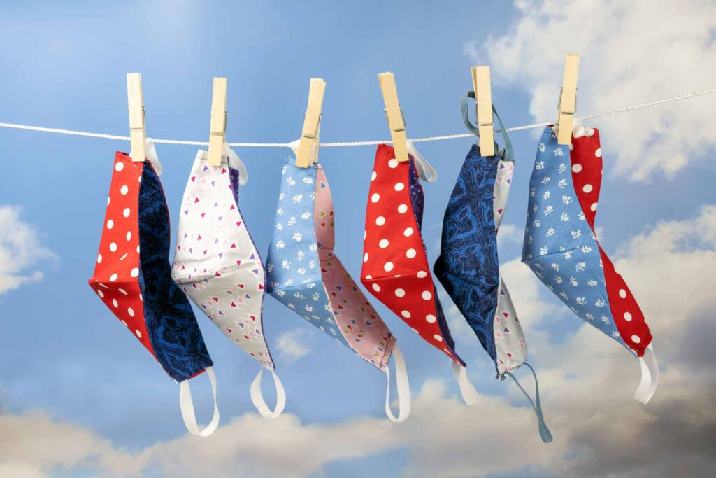 cloth face masks drying on a clothesline