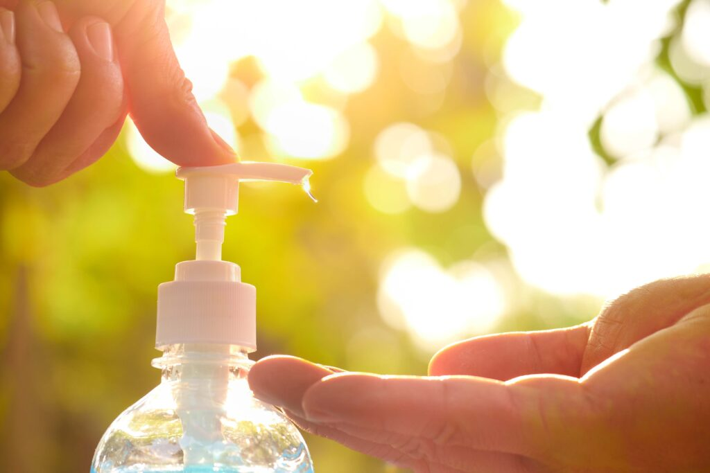A person applying hand sanitizer